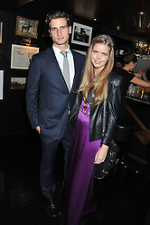 KATIE READMAN and TOM WARREN at the launch of Beulah's collaboration with Hennessy Gold Cup and a preview of the SS13 Collection held at The Brompton Club, 92b Old Brompton Road, London SW7 on 18th October 2012.