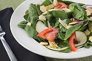 Spinach artichoke heart salad served at Craigos Pizza