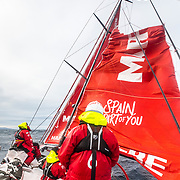 Leg 7 from Auckland to Itajai, day 12 on board MAPFRE, moment after break the main sail, 6 miles before rounding Cape Horn. Sophie, Blair and Pabbblo on deck, 29 March, 2018.