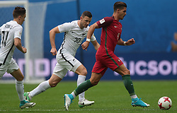 June 24, 2017 - Saint Petersburg, Russia - Tommy Smith (L) of the New Zealand national football team and André Silva of the Portugal national football team vie for the ball during the 2017 FIFA Confederations Cup match, first stage - Group A between New Zealand and Portugal at Saint Petersburg Stadium on June 24, 2017 in St. Petersburg, Russia. (Credit Image: © Igor Russak/NurPhoto via ZUMA Press)