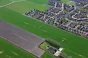 Nederland, Groningen, Bedum, 01-05-2013; dorpsuitbreiding Oosterheerd. Nieuwbouwwijk en villawijk, gebouwd in de polder, aantasting van het landschap.<br /> Oosterheerd , village expansion. New housing and residential area, built in the polder, degradation of the landscape.<br /> luchtfoto (toeslag op standard tarieven);<br /> aerial photo (additional fee required);<br /> copyright foto/photo Siebe Swart