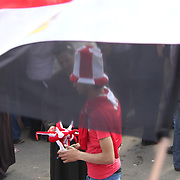 A football fan accessories vendor does swift trade as Egyptians express their hopes for their country in Cairo's Tahrir Square.