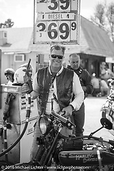 Dean Bordigioni (Dino) gassin up his 1923 Harley-Davidson JS during Stage 5 of the Motorcycle Cannonball Cross-Country Endurance Run, which on this day ran from Clarksville, TN to Cape Girardeau, MO., USA. Tuesday, September 9, 2014.  Photography ©2014 Michael Lichter.