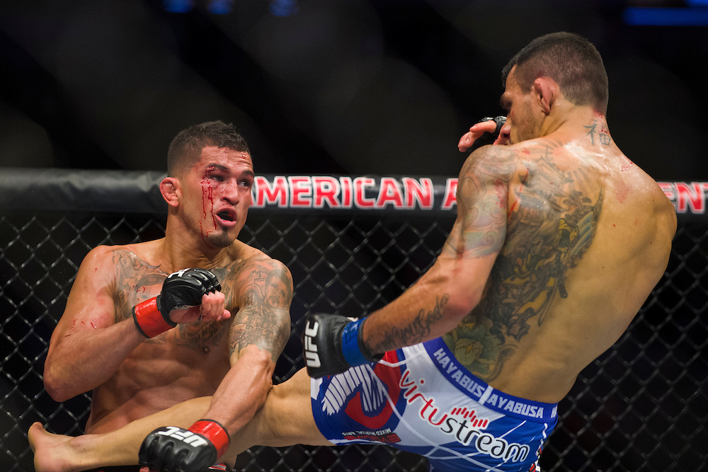 DALLAS, TX - MARCH 14:  Rafael Dos Anjos connects with a kick against Anthony Pettis during UFC 185 at the American Airlines Center on March 14, 2015 in Dallas, Texas. (Photo by Cooper Neill/Zuffa LLC/Zuffa LLC via Getty Images) *** Local Caption *** Rafael Dos Anjos; Anthony Pettis