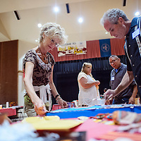 082114       Cable Hoover<br /> <br /> Beth Mount, left, and Marc Kolman help participants complete their collages during the Shining Star event at Red Rock Park Thursday.