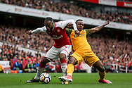 Alexandre Lacazette Of Arsenal holds off Jose Izquierdo of Brighton and Hove Albion.<br /> Premier league match, Arsenal v Brighton & Hove Albion at the Emirates Stadium in London on Sunday 1st October 2017. pic by Kieran Clarke, Andrew Orchard sports photography.