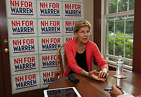 """Senator Elizabeth Warren sits down with Reporter Rick Green before Wednesday night's """"house party"""" in Wolfeboro.  (Karen Bobotas/for the Laconia Daily Sun)"""