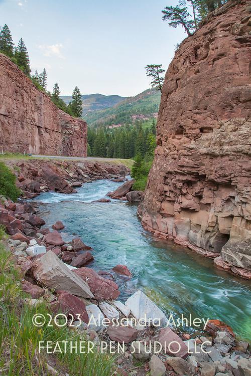 Majestic red cliffs and glacial blue stream, Redstone, Colorado.