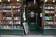 Second hand book shop window on Charing Cross Road on 18th February 2020 in London, England, United Kingdom. Charing Cross Road is renowned for its specialist and second-hand bookshops, and is home to many book shops, and more general second-hand and antiquarian shops.