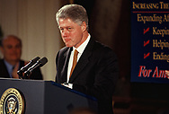 President Clinton speaks at an event in the East Room during the months of the Clinton impeachment drama.<br />Photo by Dennis Brack