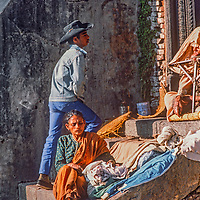 An indigent woman waits for alms of food at Pashupatinath Temple in Kathmandu, Nepal, 1986.
