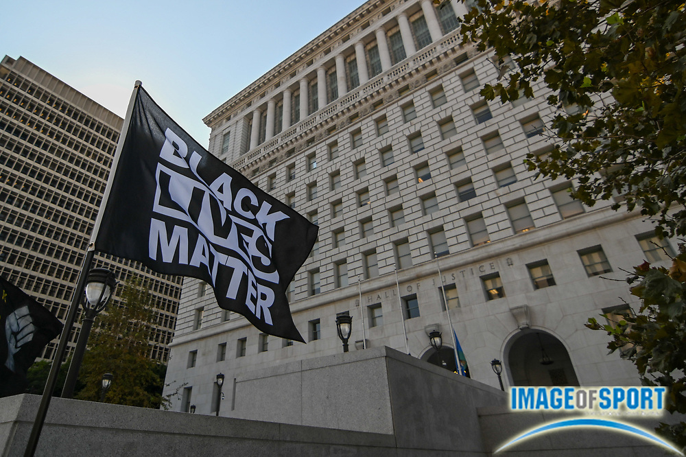 """A """"Black Lives Matter"""" flag flies outside of the Hall of Justice, Wednesday, Sept. 23, 2020, in Los Angeles. (Dylan Stewart/Image of Sport)"""