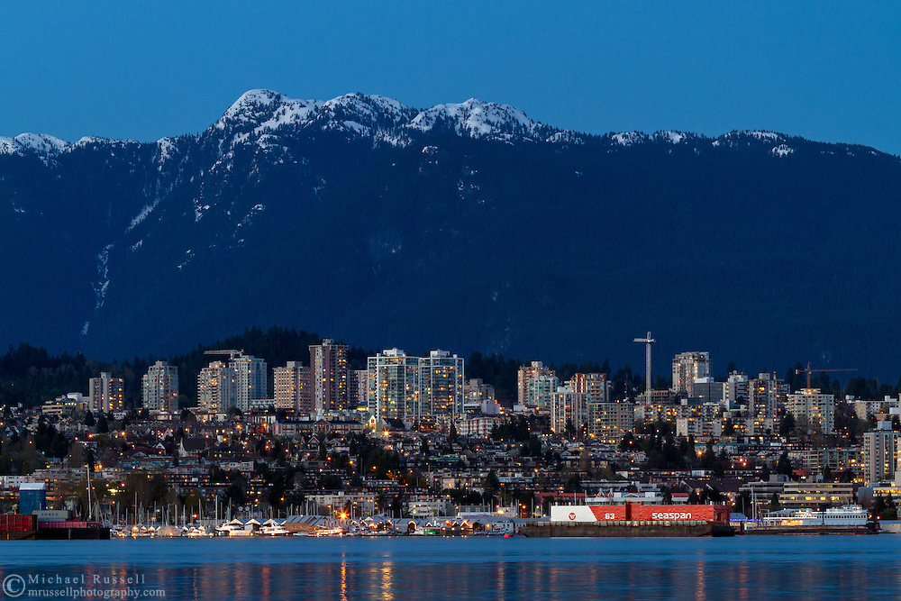 The City of North Vancouver in the early evening from Stanley Park in British Columbia, Canada