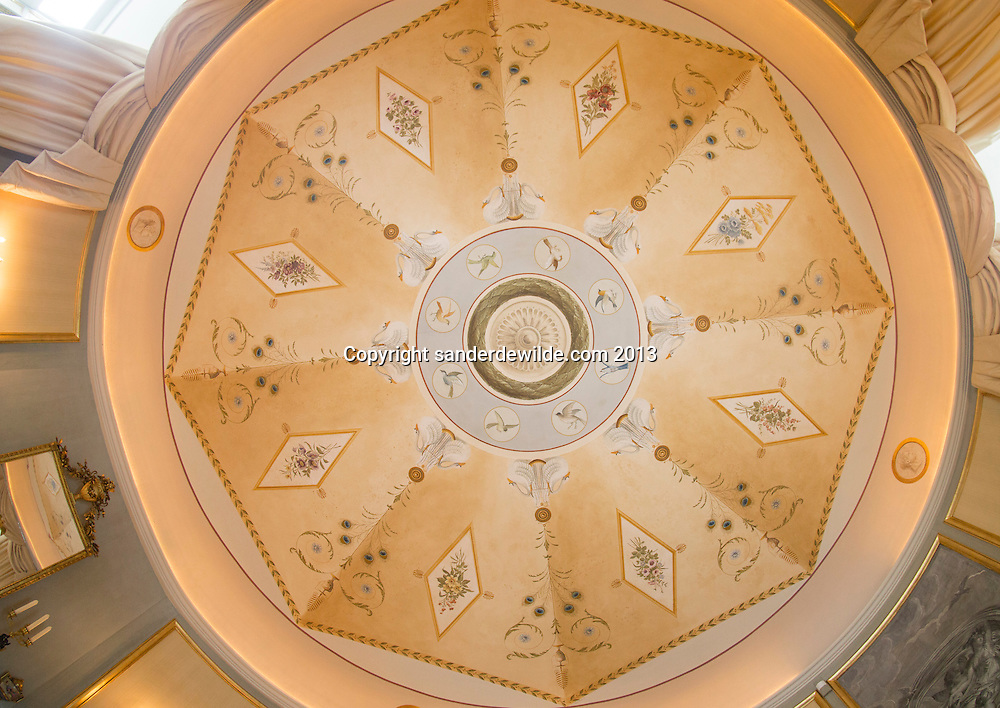 Fisheye perspective photographe of the ceiling of a round room in the castle Chateau d'Anthée. The design, drawing, painting and decorating was all done by Interior architectThierry THENAERS. 10th June 2013. Credit Sander de Wilde for The Wall Street Journal.  Castle