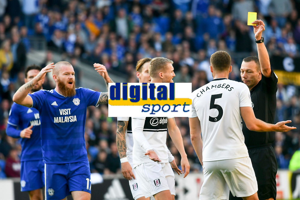 Football - 2018 / 2019 Premier League - Cardiff City vs. Fulham<br /> <br /> Referee Kevin Friend  shows the yellow card to Calum Chambers of Fulham, at Cardiff City Stadium.<br /> <br /> COLORSPORT/WINSTON BYNORTH