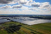 Nederland, Zuid-Holland, Gemeente Reeuwijk, 15-07-2012; Reeuwijksche Plassen (Reeuwijkse Plassen). De veenplassen zijn ontstaan door het afgraven en wegbaggeren van het veen voor het winnen van turf. Uitzondering is de plas in de voorgrond, dit is een zandwinplas ontstaan door het winnen van zand, nodig voor de aanleg van de A12..Peat lakes Reeuwijksche Plassen are created by peat and sand extraction. .luchtfoto (toeslag), aerial photo (additional fee required).foto/photo Siebe Swart