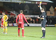 Referee Brett Huxtable gives Adam Smith of Alfreton Town  a yellow card during the The FA Cup match between Newport County and Alfreton Town at Rodney Parade, Newport, Wales on 15 November 2016. Photo by Andrew Lewis.