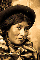 A quechua woman poses for a photo in Cusco, Peru