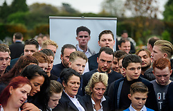 © Licensed to London News Pictures. 26/10/2017. Epsom, UK. Mourners and family members gather at the graveside at the funeral of Tom 'Tomboy' Doherty (pictured rear)  the nephew of Big Fat Gypsy Weddings star Paddy Doherty, at Epsom Cemetery in Epsom, Surrey. Tom Doherty was 17 when he was killed in a car crash in South Nutfield in Surrey on October 9. He had passed his driving test just days earlier. Photo credit: Ben Cawthra/LNP