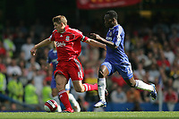 Photo: Lee Earle.<br /> Chelsea v Liverpool. The Barclays Premiership. 17/09/2006. Liverpool's Steven Gerrard (L) battles with Michael Essien.
