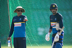 December 28, 2017 - Colombo, Western Province, Sri Lanka - Sri Lanka new head coach Chandika Hathurusingha (L) giving some tips to Test captain Dinesh Chamdimal during the first practices session (Credit Image: © Sameera Peiris/Pacific Press via ZUMA Wire)