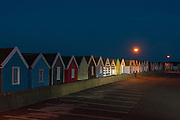 Cabanas illuminated by mercury vapor parking lot light in Southwold, England.  Licensing and Limited Edition Prints.