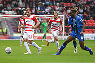 Herbie Kane of Doncaster Rovers (15) passes the ball forward with Gabriel Zakuani of Gillingham (6) defending during the EFL Sky Bet League 1 match between Doncaster Rovers and Gillingham at the Keepmoat Stadium, Doncaster, England on 20 October 2018.