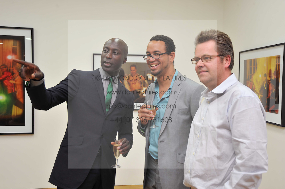 Left to right, OZWALD BOATENG, CHRIS CLEVERLY and CHARLIE PHILLIPS at a private view of Alison Jackson's photographs 'Up The Aisle' held at the Ben Brown gallery 12 Brook's Mews, London W1 on 19th April 2011.