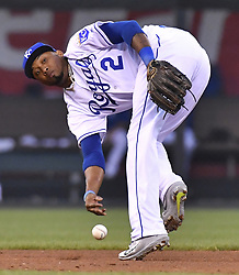 August 7, 2017 - Kansas City, MO, USA - Kansas City Royals shortstop Alcides Escobar tries to throw to second after dropping a grounder for an error that was hit by St. Louis Cardinals' Kolten Wong and allowed Jose Martinez to score and Dexter Fowler to reach second in the fourth inning at Kauffman Stadium on Aug. 7, 2017 in Kansas City, Mo. (Credit Image: © John Sleezer/TNS via ZUMA Wire)