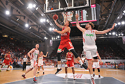 14.06.2015, Brose Arena, Bamberg, GER, Beko Basketball BL, Brose Baskets Bamberg vs FC Bayern Muenchen, Playoffs, Finale, 3. Spiel, im Bild Daniel Theis (Brose Baskets Bamberg / vorne links) beim Korbleger. Vorne rechts: John Bryant (FC Bayern Muenchen). Hinten links: Dusko Savanovic (FC Bayern Muenchen) // during the Beko Basketball Bundes league Playoffs, final round, 3rd match between Brose Baskets Bamberg and FC Bayern Muenchen at the Brose Arena in Bamberg, Germany on 2015/06/14. EXPA Pictures © 2015, PhotoCredit: EXPA/ Eibner-Pressefoto/ Merz<br /> <br /> *****ATTENTION - OUT of GER*****