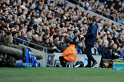 Tottenham Hotspur Manager, Andre Villas Boas looks away from the action - Photo mandatory by-line: Dougie Allward/JMP - Tel: Mobile: 07966 386802 24/11/2013 - SPORT - Football - Manchester - Etihad Stadium - Manchester City v Tottenham Hotspur - Barclays Premier League