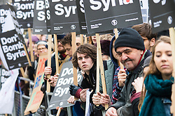 London, November 28th 2015. As Prime Minister David Cameron pushes for Parliament to vote to allow aerial strikes against Islamic State targets in Syria, Britain's Stop The War Coalition and thousands of anti-war protesters demonstrate outside Downing Street. PICTURED:   //// FOR LICENCING CONTACT: paul@pauldaveycreative.co.uk TEL:+44 (0) 7966 016 296 or +44 (0) 20 8969 6875. ©2015 Paul R Davey. All rights reserved.