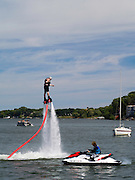 """A man """"flies"""" on a flyboard on Lake Mendota, in front of the Memorial Union, University of Wisconsin-Madison."""