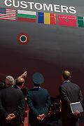 Looking closely at a C-27J Spartan gunship, foreign military visitors to Italian aerospace and defence Finmeccanica's exhibition stand at the Farnborough Air Show. The Alenia C-27J Spartan is a medium-sized military transport aircraft. The C-27J is an advanced derivative of Alenia Aeronautica's G.222 (C-27A Spartan in U.S. service), with the engines and systems of the Lockheed Martin C-130J Super Hercules. The aircraft was selected as the Joint Cargo Aircraft (JCA) for the United States military. The C-27J has also been ordered by the military air units of Australia, Italy, Greece, Bulgaria, Lithuania, Mexico, Morocco and Romania.
