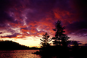 Stormy evening sunset over island in lake - Quebec, Canada