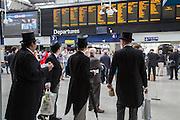 Royal Ascot racegoers at Waterloo station. London. 20 June 2013.