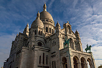 Basilique du Sacre Coeur - the Basilica of the Sacred Heart of Paris is usually referred to as Sacre Coeur is the second most visited monument in Paris after the Eiffel Tower.  Its prime location at the summit of Montmartre gives it a striking overview over Paris, for an even greater view visitors can go further up into the dome where the 360 degree view of Paris is magnificent. The basilica was designed by Paul Abadie and was completed in 1914 and consecrated after WWI in 1919.