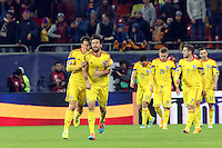 ROMANIA, Bucharest : Romania's Vlad Chiriches (L) and Paul Papp (R) celebrate after scoring his first goal during the Euro 2016 Group F qualifying football match Romania vs Northern Ireland in Bucharest, Romania on November 14, 2014.