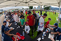 KELOWNA, CANADA - JUNE 28: Fans line up for autograph signing prior to the opening charity game of the Home Base Slo-Pitch Tournament fundraiser for the Kelowna General Hospital Foundation JoeAnna's House on June 28, 2019 at Elk's Stadium in Kelowna, British Columbia, Canada.  (Photo by Marissa Baecker/Shoot the Breeze)