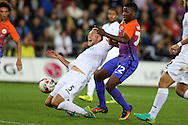 Mike Van der Hoorn of Swansea city slides in to block Kelechi Iheanacho of Manchester city.   EFL Cup. 3rd round match, Swansea city v Manchester city at the Liberty Stadium in Swansea, South Wales on Wednesday 21st September 2016.<br /> pic by  Andrew Orchard, Andrew Orchard sports photography.