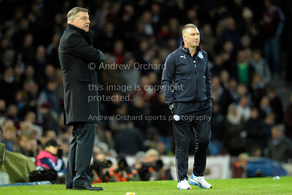 West Ham United manager Sam Allardyce (l) and Leicester City manager Nigel Pearson looking on at their players from the touchline. Barclays Premier league match, West Ham Utd v Leicester city at the Boleyn ground, Upton Park in London on Sat 20th December 2014.<br /> pic by John Patrick Fletcher, Andrew Orchard sports photography.