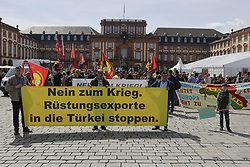 April 14, 2018 - Mannheim, Baden-Württemberg, Germany - Protesters carry a banner that reads 'No to war - Stop weapons export to Turkey'. Kurdish people and German supporters marched through Mannheim to protest against the continued occupation of the Syrian city of Afrin, which was controlled by the Kurdish Popular Protection Units (YPG) before it got conquered by the Turkish army. They also protested against the German involvement via weapons exports to Turkey. (Credit Image: © Michael Debets/Pacific Press via ZUMA Wire)