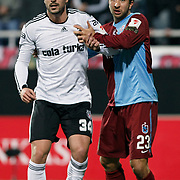 Besiktas's Hugo ALMEIDA (L) and Trabzonspor's Remzi Giray KACAR (R) during their Turkey Cup Group B matchday 5 soccer match Besiktas between Trabzonspor at the Inonu stadium in Istanbul Turkey on Wednesday 26 January 2011. Photo by TURKPIX