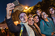 Students dressed in skeleton costume take a selfie during the Day of the Dead festival in the Plaza Civica October 28, 2016 in San Miguel de Allende, Guanajuato, Mexico. The week-long celebration is a time when Mexicans welcome the dead back to earth for a visit and celebrate life.