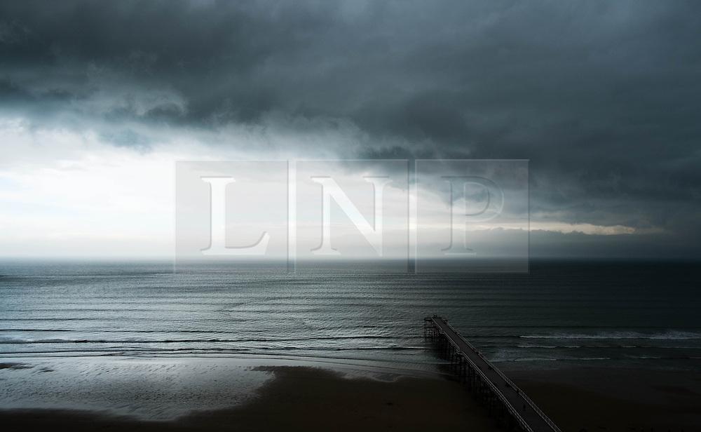 © Licensed to London News Pictures. 07/04/2014<br /> <br /> Saltburn, United Kingdom<br /> <br /> Dark storm clouds form over Saltburn by the Sea in Cleveland.<br /> <br /> Photo credit : Ian Forsyth/LNP