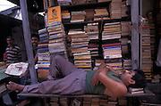 Bookstall keeper takes a nap, College Street, Calcutta