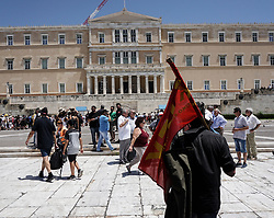 June 14, 2018 - Athens, Greece - A protester stands in front of parliament building during a rally against the multi-bill with the prerequisites for the completion of the 4th evaluation voted by the government in the Hellenic parliament. (Credit Image: © SOPA Images via ZUMA Wire)