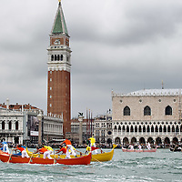 VENICE, ITALY - SEPTEMBER 04:  Rowers on traditional Venetian boats 'Caorline' take part in one of the races of the Historic Regata on September 4, 2011 in Venice, Italy. The Historic Regata is the most popular boat race on the Gran Canal for locals and tourists alike. San Marco is one of the six sestieri of Venice, lying in the heart of the city.