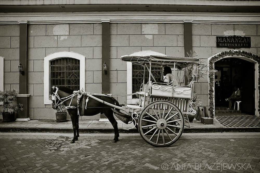 Philippines, Manila. Kalesa, a horse-drawn carriage in Intramuros, the oldest part of Manila.