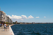 The waterfront. Walking along the seafront. Group of tourists taking pictures. Thessaloniki, Macedonia, Greece